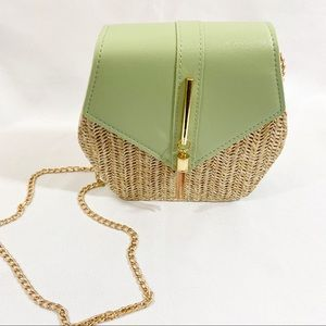Square straw gold accented shoulder purse.